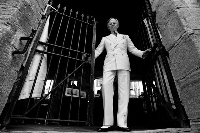 Seeing as he's an artist, Tom Wolfe must always be photographed in white from a low angle.