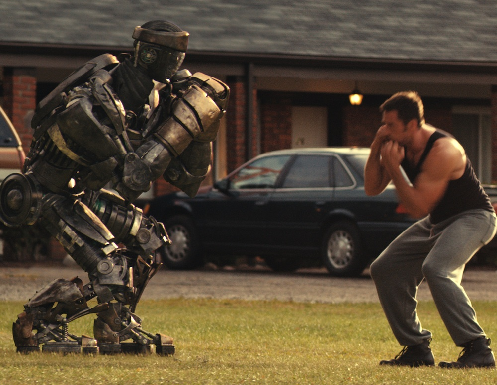 Hugh Jackman shadowboxes Atom in Real Steel